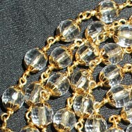 Sphatik Diamond cut mala in gold - 6mm