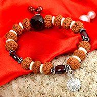 9 Mukhi Rudraksha with Gomed Bracelet (Crown)