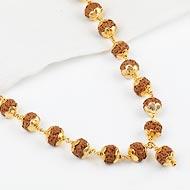 Rudraksha Chikna Mala 7 mm in designer Gold Flower Caps