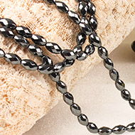 Hematite Faceted Drumshape Mala - 8 mm