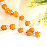 Tumeric mala in silver with knots