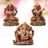 Ganesha Lakshmi and Saraswati Idols in pure Ruby