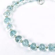 Aquamarine button shape bracelet with silver balls - Faceted beads