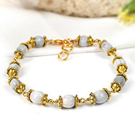 White Vaijayanti bracelet in designer gold polish caps