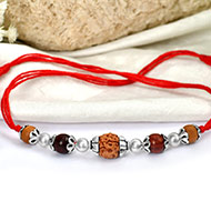 4 Mukhi Rakhi Sandal beads with silver accessories in thread