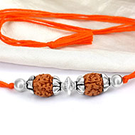 4 mukhi Rakhi with pure silver accessories in thread - III