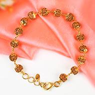 Punch mukhi Chikna bead bracelet with gold flower caps - II