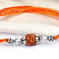 4 mukhi Rakhi with pure silver accessories in thread - ii