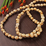White chirmi beads mala