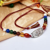 Gemstone Rakhi with pure silver and metal accessories - OM design