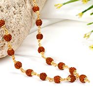Rudraksha mala - 7 mm in gold polished copper..