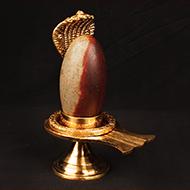 Brass Yoni base with Narmada Shivling - IV