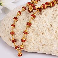 Rudraksha Mala 5mm in gold with flower design..