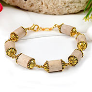 Cylindrical Tulsi bracelet in designer gold polish caps