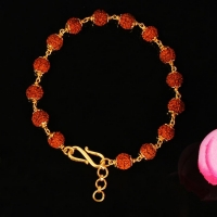Rudraksha punchmukhi bracelet with gold flowe..