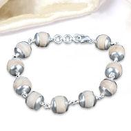 Tulsi Bracelet in plain silver caps - 11mm