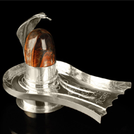 Tiger eye Lingam on silver Yoni  base