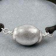Lingam shape Parad Gutika Bracelet in silver caps - 22 to 24mm
