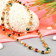 Navratna mala precious gems in gold caps