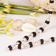 Black Tulsi Mala in silver flower caps