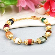Navratna Bracelet in gold designer caps - Design I
