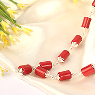 Cylindrical Coral Mala in pure silver flower caps