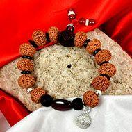 9 Mukhi Rudraksha with Gomed and Black Ebony Bracelet (Crown)