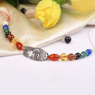 Gemstone Rakhi with pure silver and metal accessories - Shree design