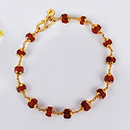 Rudraksha Bracelet in gold with flower design..