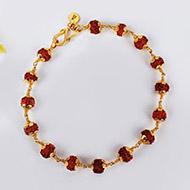 Rudraksha Bracelet in gold with flower design caps