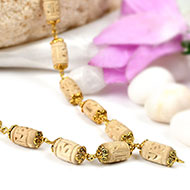Designer Tulsi mala in designer gold polish caps