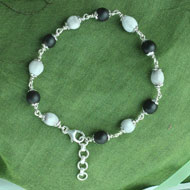White and Black Vaijayanti Bracelet in pure silver flower caps