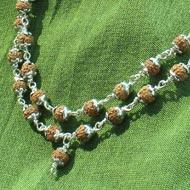 Rudraksha mala 4mm in silver flower caps