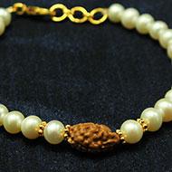 2 Mukhi Rakhi Pearl Beads with Panchdhatu Chakri