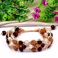 Semi Chikna Rudraksha with Red sandal beads and Sphatik Faceted beads bracelet