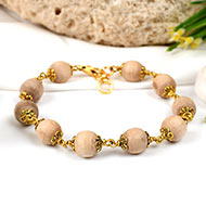 Tulsi bracelet in designer gold polish caps