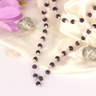 Amethyst beads mala in Pure silver flower cap..