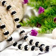 Black Tulsi Mala in silver flower caps - 9 mm