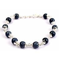 Blue Sapphire Bracelet with flower silver caping - Round