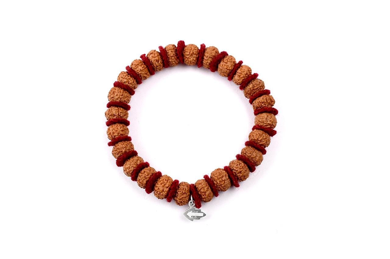 10 mukhi Krishna bracelet from Java in woolen spacers