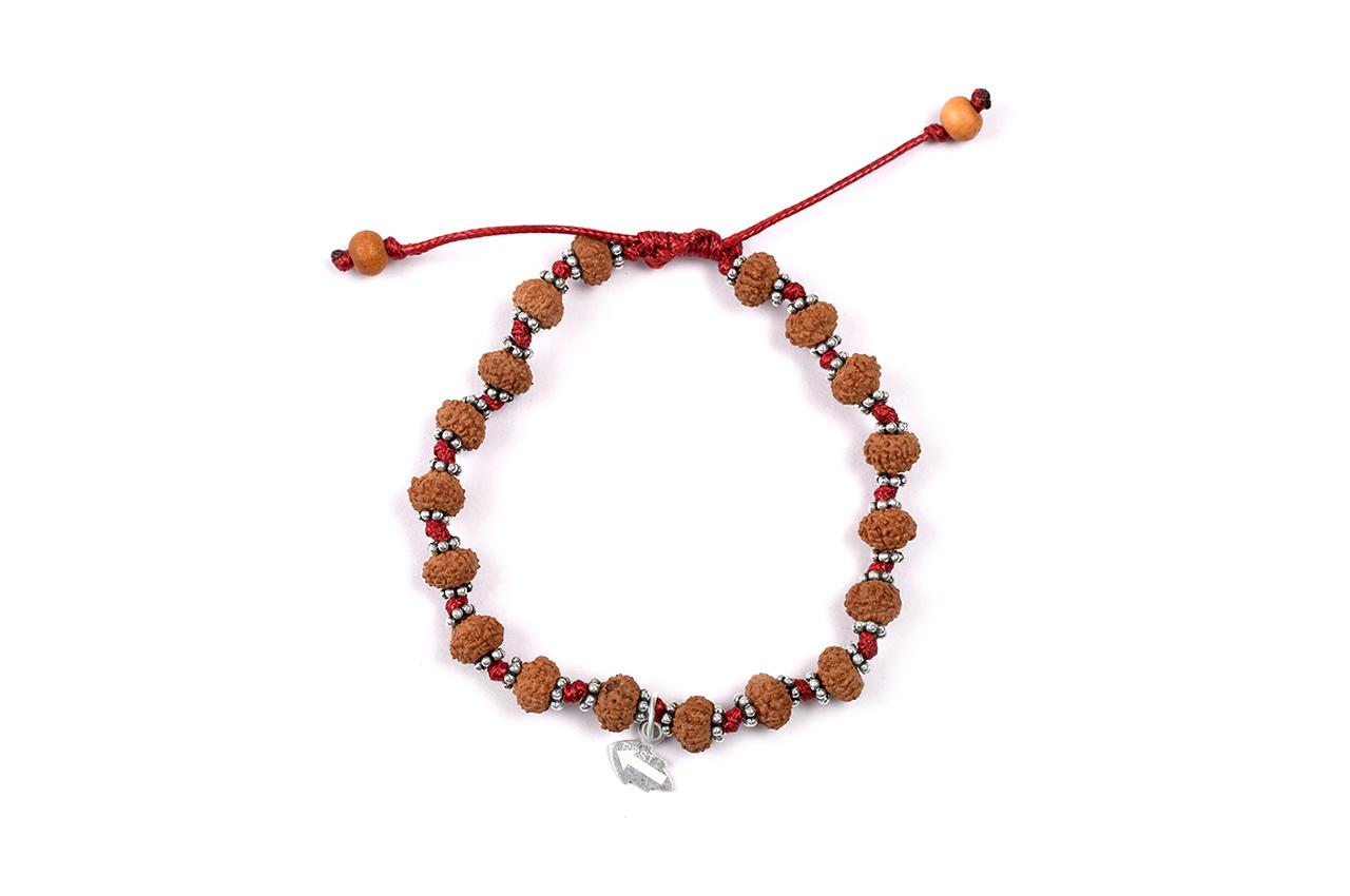9 mukhi Durga Shakti bracelet from Java with silver chakri in thread