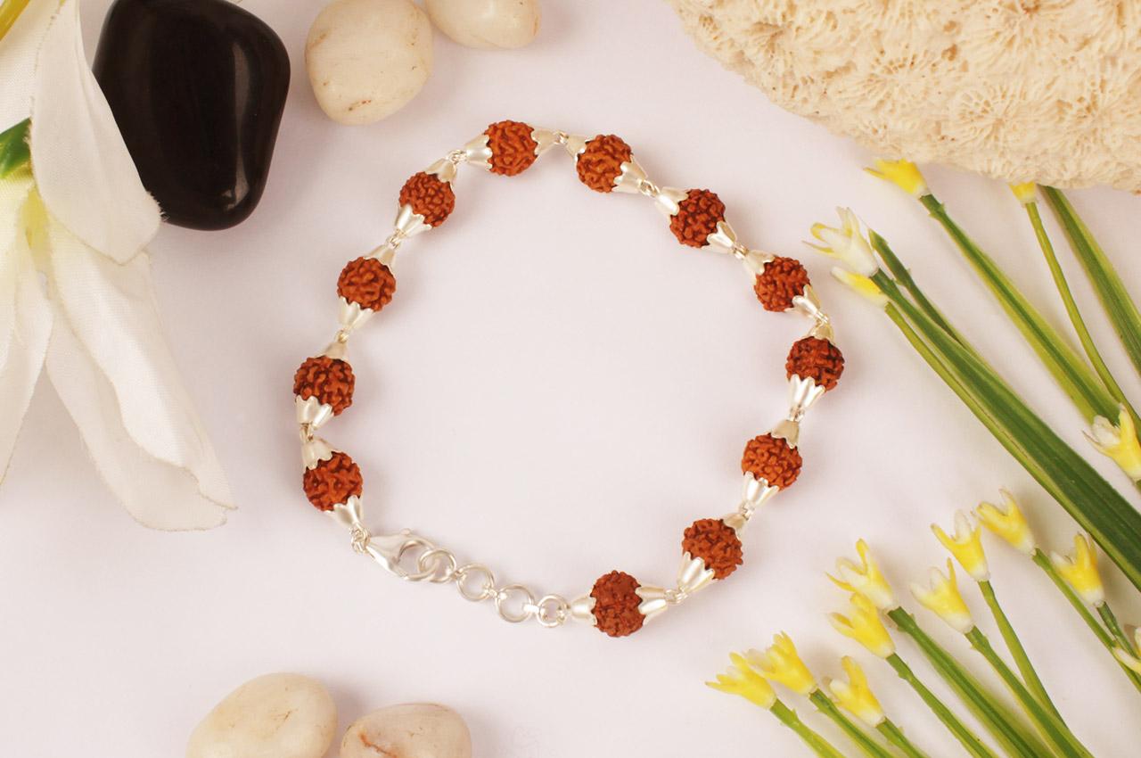 Rudraksha punchmukhi Bracelet in conical silver flower caps