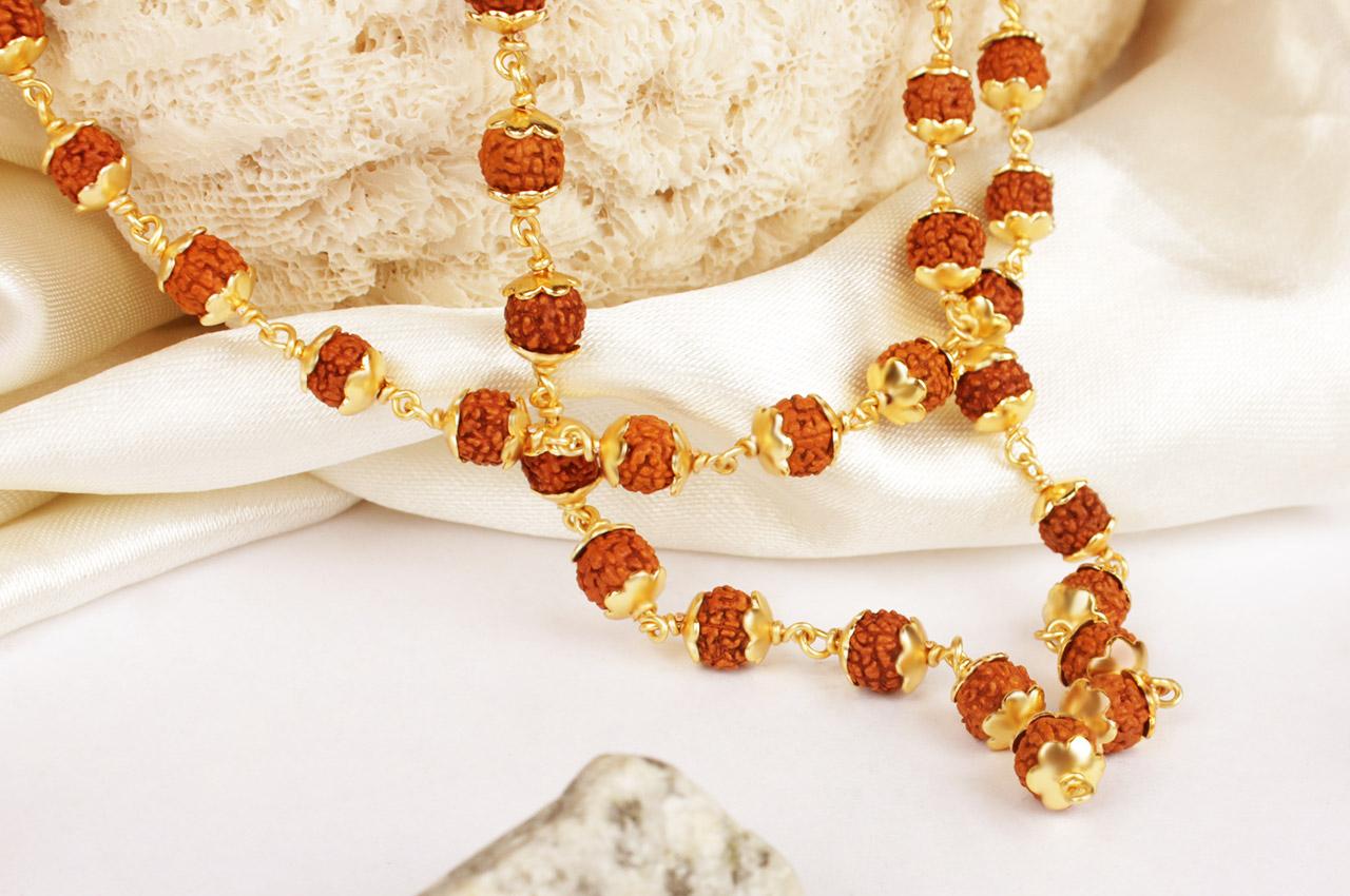 Rudraksha mala 6mm in gold polished copper caps
