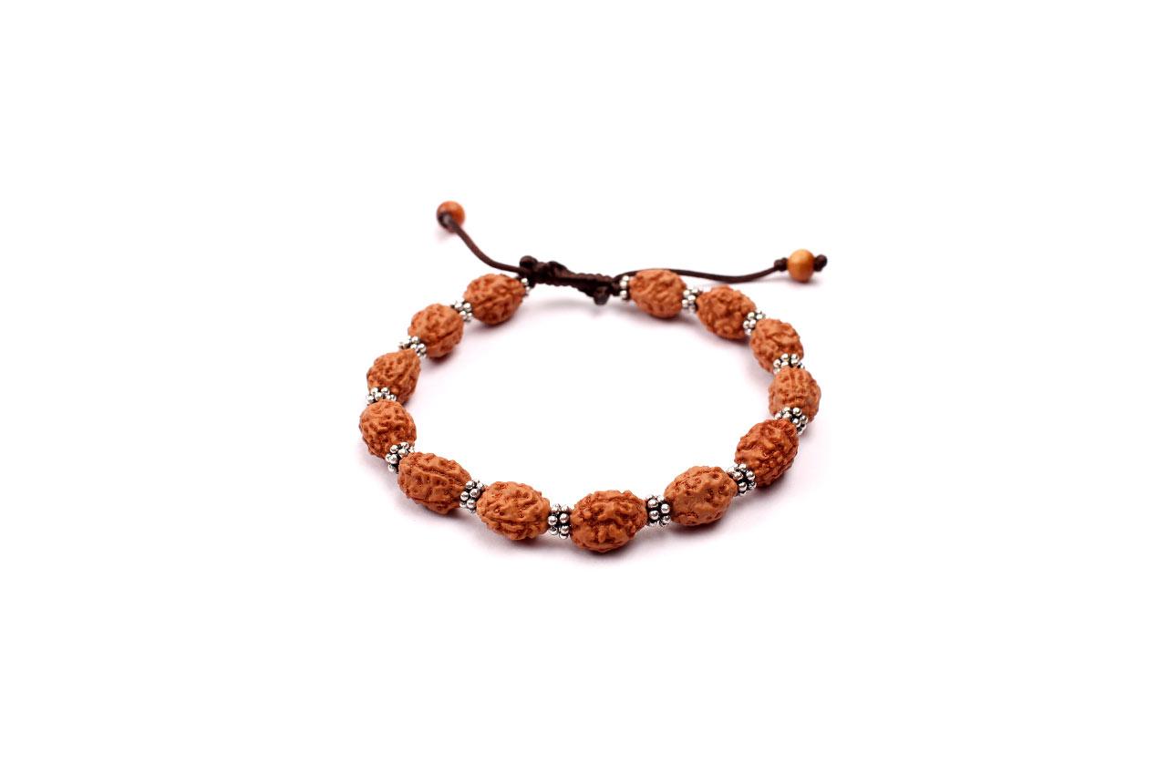 3 mukhi Mahajwala bracelet from Java with silver chakri in thread