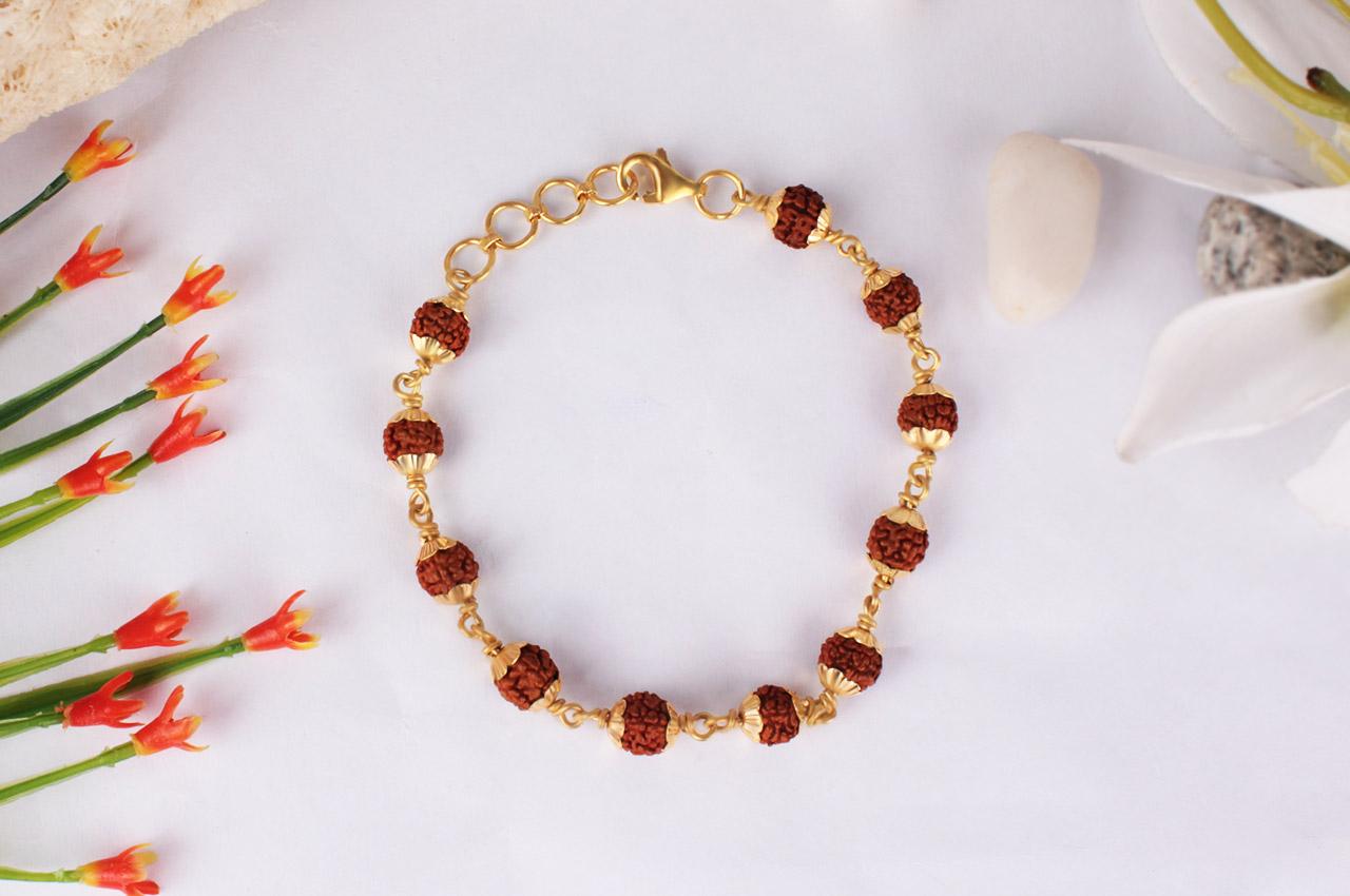 Rudraksha punchmukhi bracelet with gold flower caps
