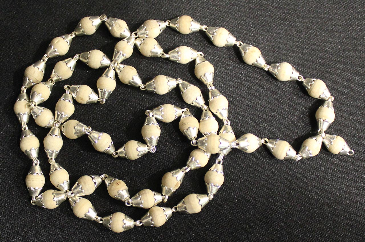 White Tulsi Mala in silver flower caps