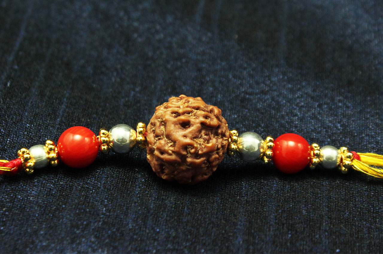 6 Mukhi Rakhi Coral Beads with Silver and Panchdhatu accessories