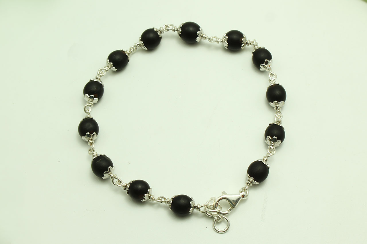 a46af2035eb Black Vaijayanti Bracelet in pure silver flower caps - Rudraksha Ratna