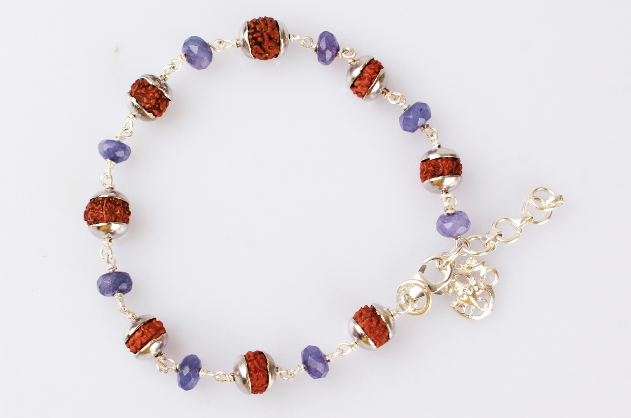 7 Mukhi with Blue Sapphire bracelet in silver caps