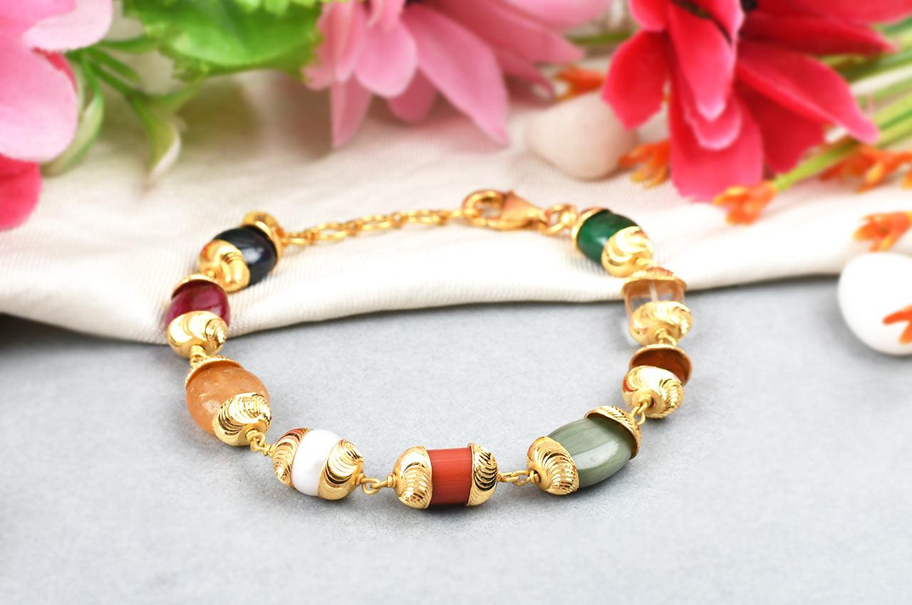 Navratna Bracelet in gold designer caps - Design I